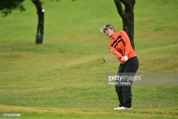 Ayaka Watanabe of Japan chips onto the 8th green during the first round of the Stanley Ladies Golf Tournament at the Tomei Country Club on October 9,...