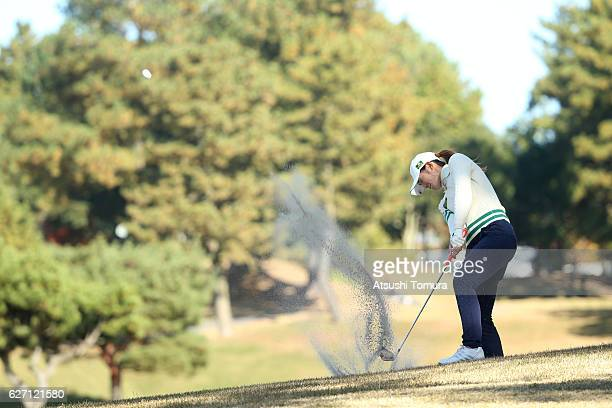 Ayaka Watanabe of Japan hits from a bunker on the 15th hole during the first round of the THE QUEENS Presented By KOWA at the Miyoshi Country Club...
