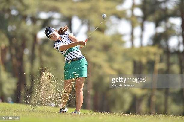 Ayaka Watanabe of Japan hits her second shot on the 14th hole during the first round of the World Ladies Championship Salonpas Cup at the Ibaraki...
