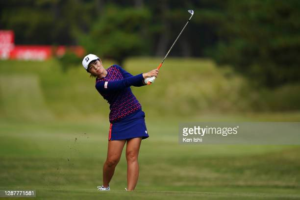 Ayaka Watanabe of Japan hits her second shot on the 17th hole during the first round of the JLPGA Tour Championship Ricoh Cup at the Miyazaki Country...