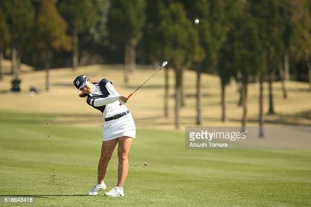 Ayaka Watanabe of Japan hits her second shot on the 18th hole during the T-Point Ladies Golf Tournament at the Wakagi Golf Club on March 20, 2016 in...