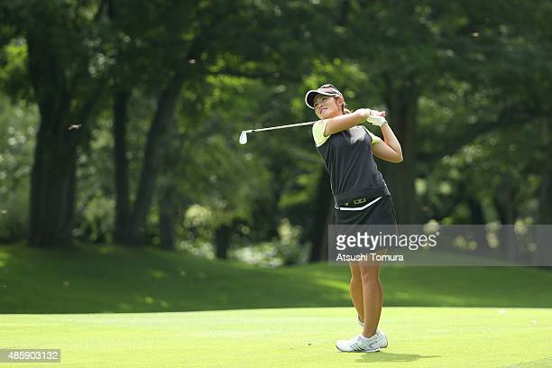 Ayaka Watanabe of Japan hits her second shot on the 9th hole during the final round of the Nitori Ladies 2015 at the Otaru Country Club on August 30...