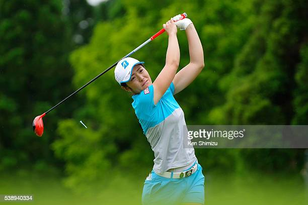Ayaka Watanabe of Japan hits her tee shot on the 13th hole during the first round of the Suntory Ladies Open at the Rokko Kokusai Golf Club on June 9...