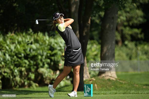 Ayaka Watanabe of Japan hits her tee shot on the 4th hole during the final round of the Nitori Ladies 2015 at the Otaru Country Club on August 30...