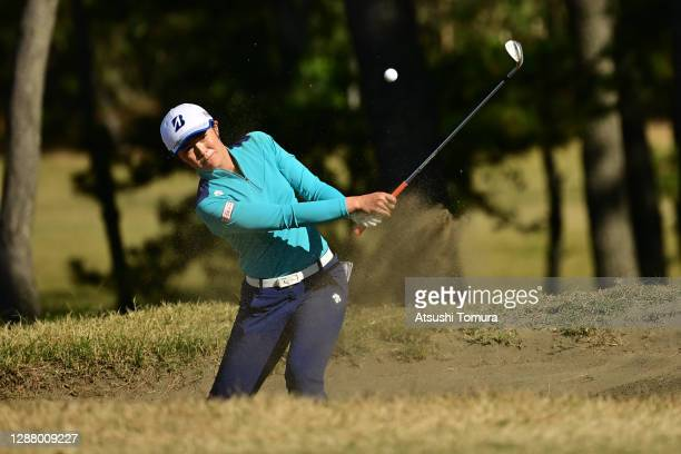 Ayaka Watanabe of Japan hits out from a bunker on the 5th hole during the second round of the JLPGA Tour Championship Ricoh Cup at the Miyazaki...