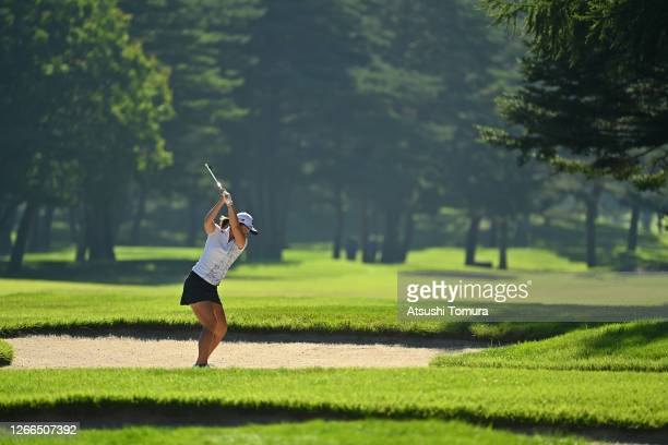 Ayaka Watanabe of Japan hits out her second shot from a bunker on the 2nd hole during the final round of the NEC Karuizawa 72 Golf Tournament at the...