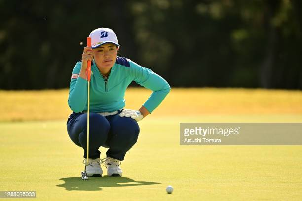 Ayaka Watanabe of Japan lines up a putt on the 13th green during the second round of the JLPGA Tour Championship Ricoh Cup at the Miyazaki Country...