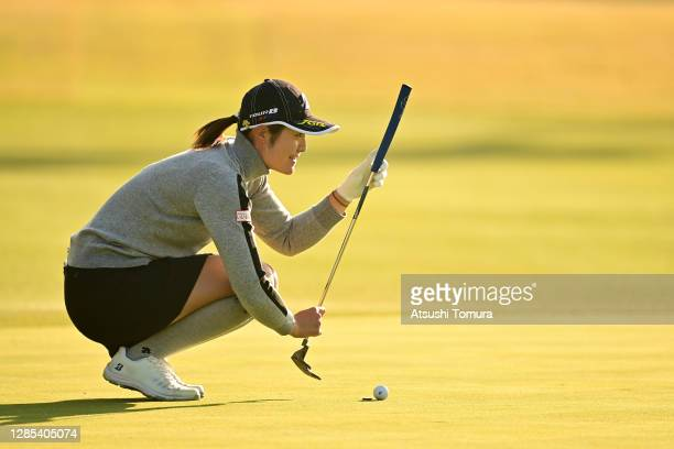 Ayaka Watanabe of Japan lines up a putt on the 17th green during the first round of the Ito-En Ladies Golf Tournament at the Great Island Club on...