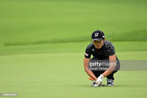 Ayaka Watanabe of Japan lines up a putt on the 3rd green during the third round of the Nitori Ladies Golf Tournament at the Otaru Country Club on...