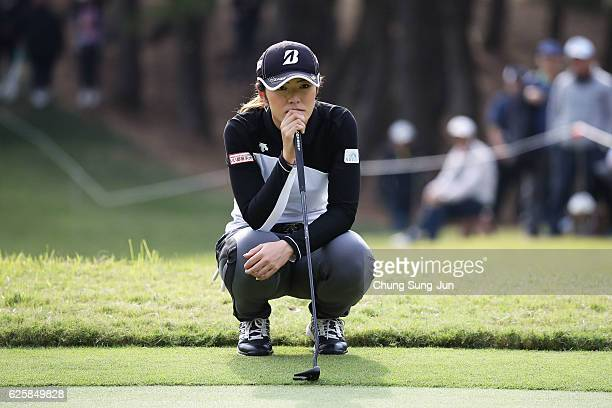 Ayaka Watanabe of Japan looks over a green on the 14th hole during the third round of the LPGA Tour Championship Ricoh Cup 2016 at the Miyazaki...