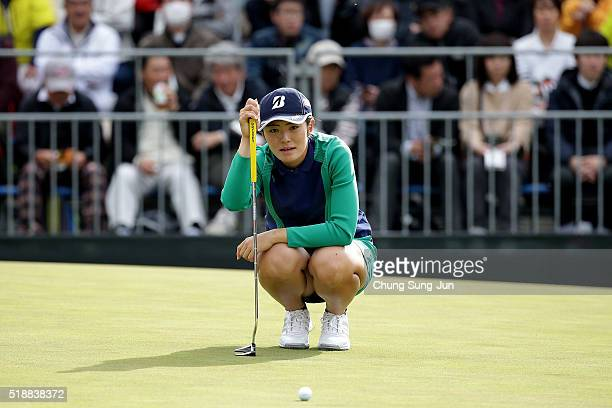 Ayaka Watanabe of Japan looks over a green on the 18th green during the final round of the YAMAHA Ladies Open Katsuragi at the Katsuragi Golf Club...