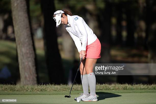 Ayaka Watanabe of Japan plays a putt on the 18th green during the second round of the LPGA Tour Championship Ricoh Cup 2016 at the Miyazaki Country...