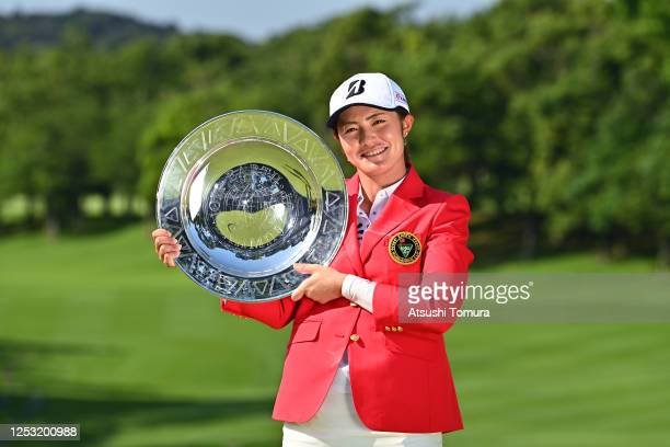 Ayaka Watanabe of Japan poses with the trophy after the award ceremony following the final round of the Earth Mondamin Cup at the Camellia Hills...
