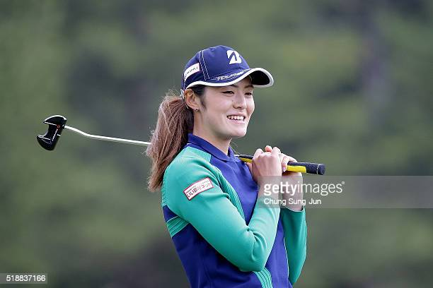 Ayaka Watanabe of Japan reacts after a putt on the 9th green during the final round of the YAMAHA Ladies Open Katsuragi at the Katsuragi Golf Club...