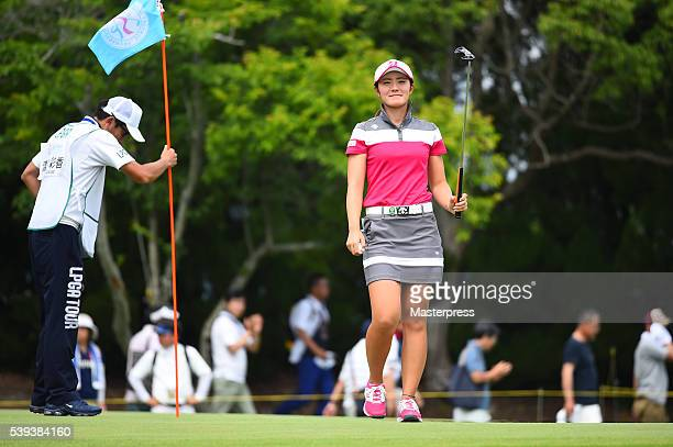 Ayaka Watanabe of Japan reacts after making her birdie putt on the 15th hole during the third round of the Suntory Ladies Open at the Rokko Kokusai...