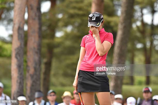 Ayaka Watanabe of Japan reacts after missing her putt on the 16th green during the World Ladies Championship Salonpas Cup at the Ibaraki Golf Club on...