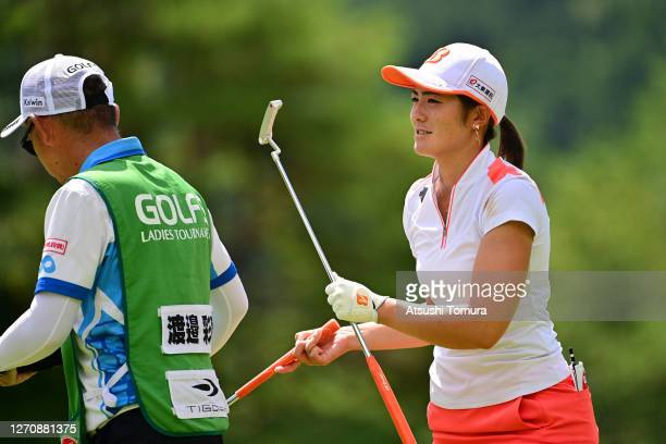 Ayaka Watanabe of Japan receives her putter on the 7th hole during the final round of the GOLF5 Ladies Tournament at the GOLF5 Country Mizunami...