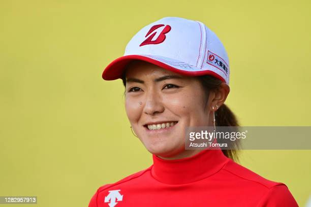 Ayaka Watanabe of Japan smiles after holing out on the 18th green during the first round of the Hisako Higuchi Mitsubishi Electric Ladies Golf...