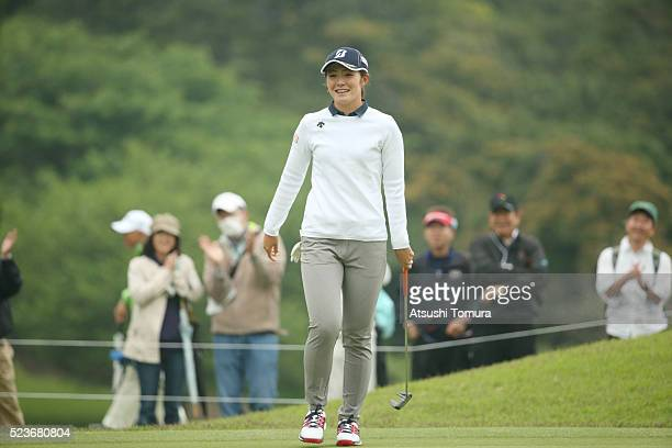 Ayaka Watanabe of Japan smiles after making her birdie putt on the 2nd green during the final round of the Fujisankei Ladies Classic at the Kawana...
