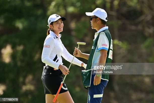 Ayaka Watanabe of Japan smiles as she holes out with the birdie during the first round of the Japan Women's Open Golf Championship at the Classic...