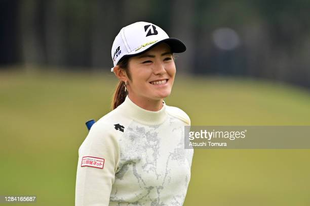 Ayaka Watanabe of Japan smiles on the 18th green during the first round of the TOTO Japan Classic at the Taiheiyo Club Minori Course on November 6,...