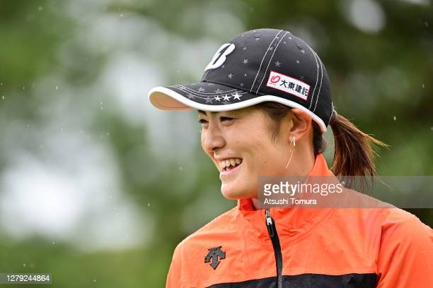 Ayaka Watanabe of Japan smiles on the 1st tee during the first round of the Stanley Ladies Golf Tournament at the Tomei Country Club on October 9,...