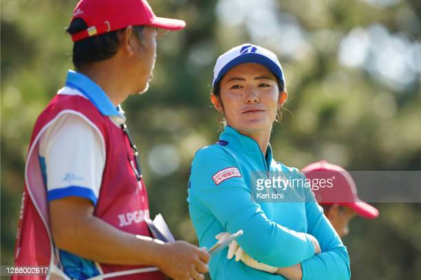 Ayaka Watanabe of Japan talks with her caddie on the 4th tee during the second round of the JLPGA Tour Championship Ricoh Cup at the Miyazaki Country...