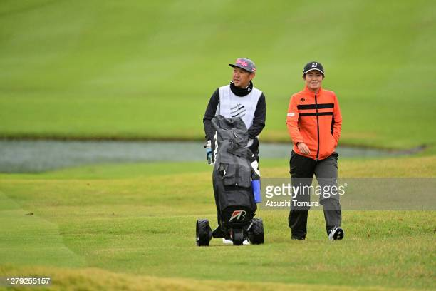 Ayaka Watanabe of Japan walks with her caddie Atsushi Kawaguchi on the 8th hole during the first round of the Stanley Ladies Golf Tournament at the...