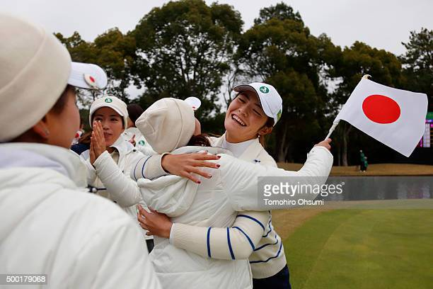 Ayaka Watanabe of the Ladies Professional Golf Association of Japan team right celebrates with her team members after winning THE QUEENS Presented By...