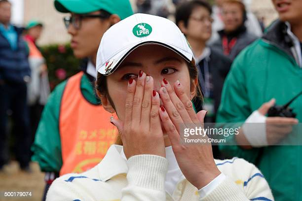 Ayaka Watanabe of the Ladies Professional Golf Association of Japan team cries after winning THE QUEENS Presented By KOWA at the Miyoshi Country Club...