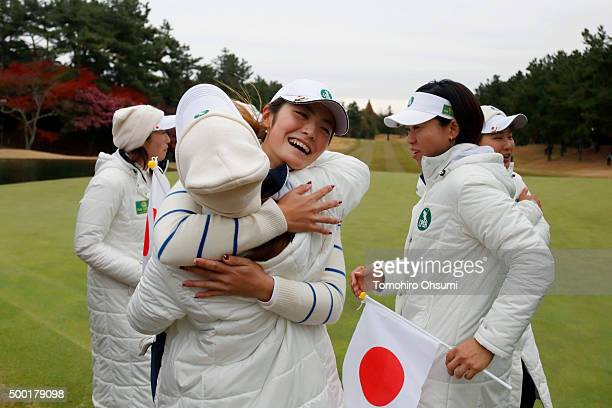 Ayaka Watanabe of the Ladies Professional Golf Association of Japan team center celebrates with her team members after winning THE QUEENS Presented...