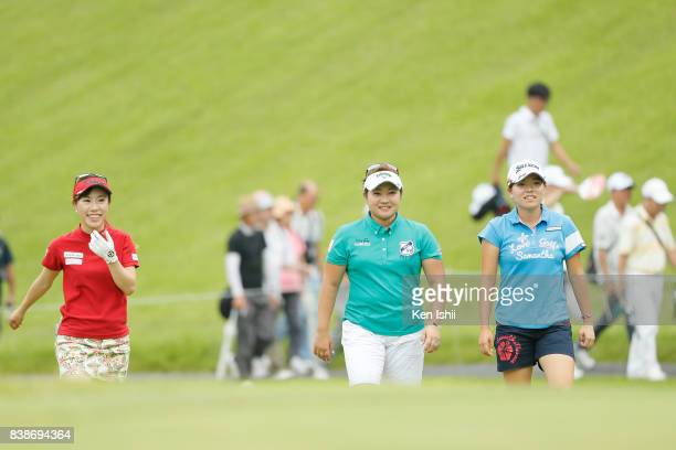 Ayako Kimura Kurumi Dohi and Minami Katsu of Japan walk on the 17th hole during the final round of the Gogin Duo Card Ladies at the Daisen Heigen...