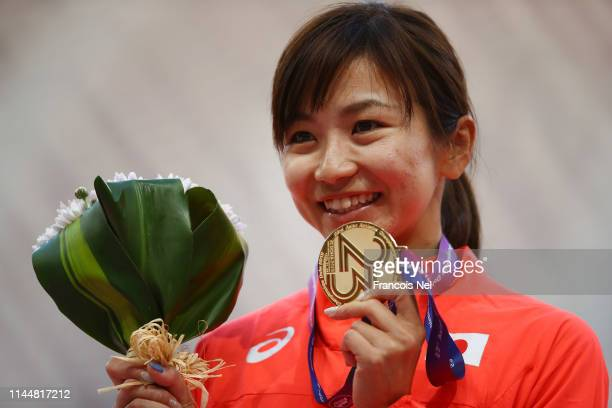Ayako Kimura of Japan celebrates with the gold medal after winning the Women's 100m Hurdles race during Day Four of the 23rd Asian Athletics...