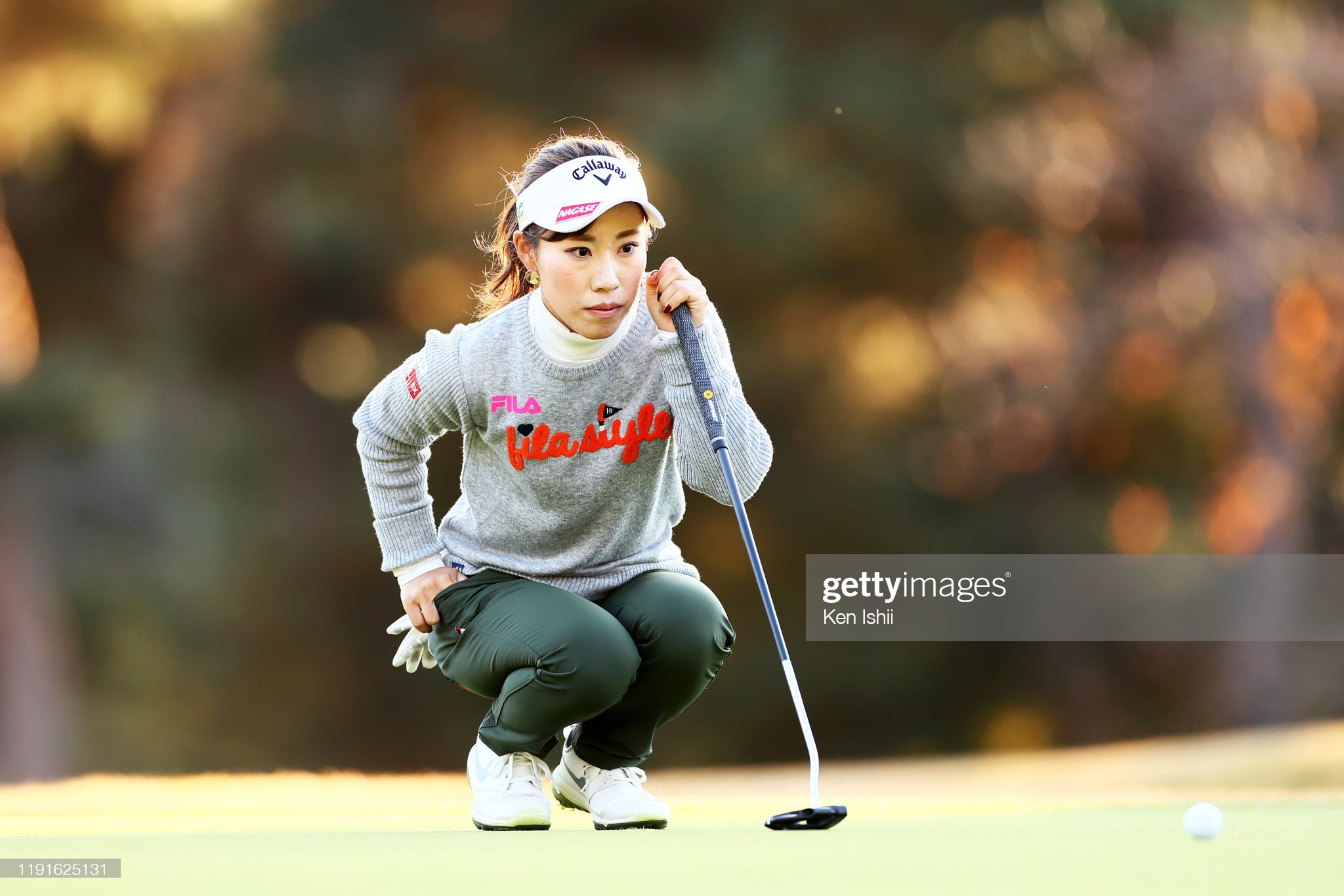 https://media.gettyimages.com/photos/ayako-kimura-of-japan-lines-up-a-putt-on-the-18th-green-during-the-picture-id1191625131?s=2048x2048
