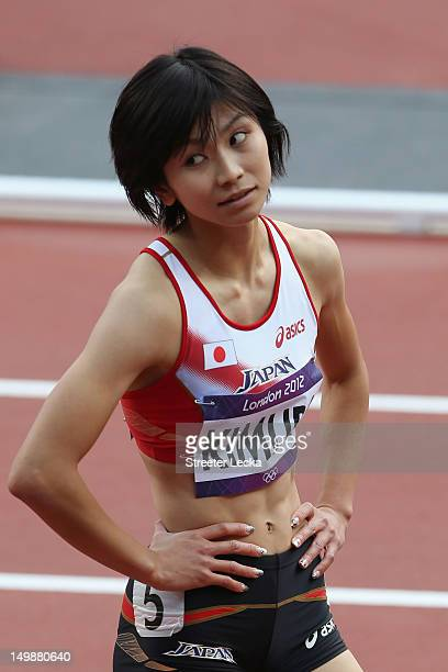 Ayako Kimura of Japan looks on after she competes in the Women's 100m Hurdles heat on Day 10 of the London 2012 Olympic Games at the Olympic Stadium...