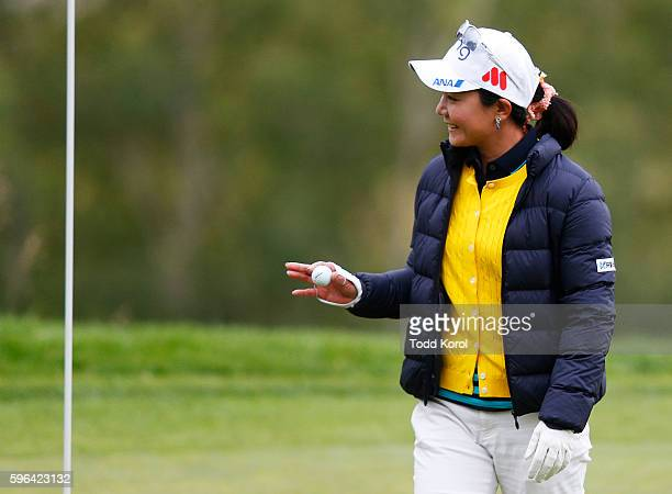 Ayako Uehara of Japan gets her ball from the 11th hole after she shot a hole in one during the third round of the Canadian Pacific Women's Open at...