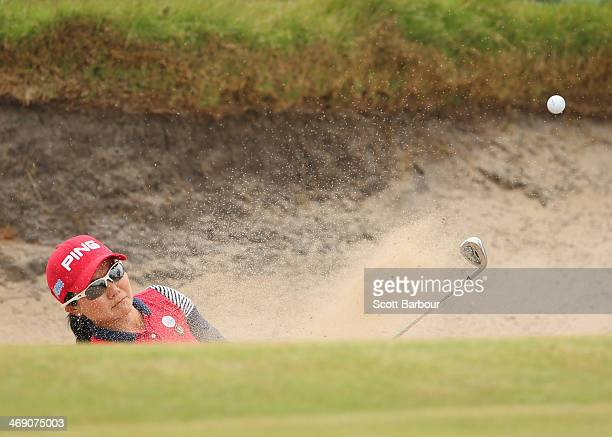 Ayako Uehara of Japan plays out of a bunker during day one of the ISPS Handa Women's Australian Open at The Victoria Golf Club on February 13, 2014...
