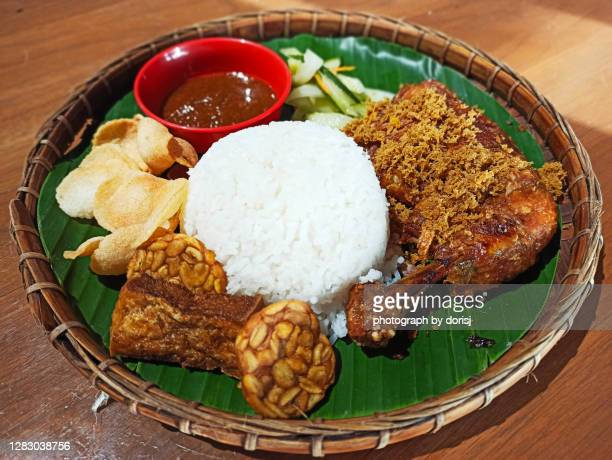 'ayam penyet' indonesian traditional fried chicken served on bamboo tray - sabah state stock pictures, royalty-free photos & images