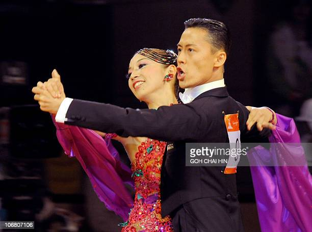 Ayami Kubo and Masayuki Ishihara of Japan compete in the dancesport standard quickstep event at the 16th Asian Games in Guangzhou on November 13 2010...