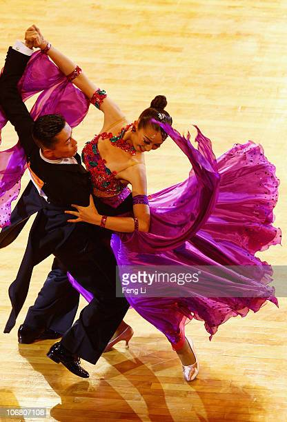 Ayami Kubo and Masayuki Ishihara of Japan compete in the the StandardQuickstep of the Dance Sports at the Zengcheng Gymnasium during day one of the...