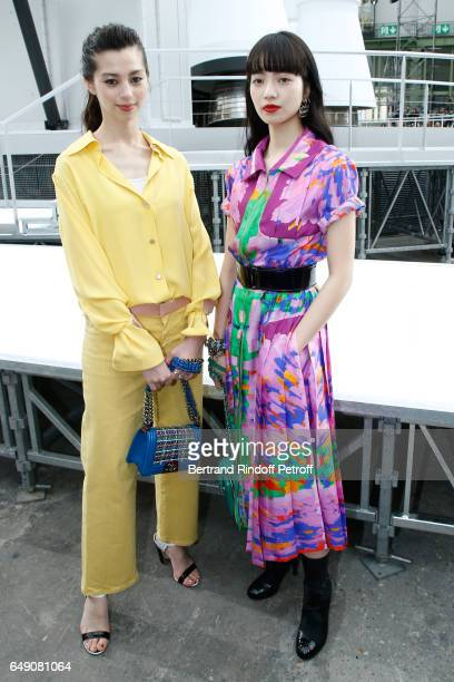Ayami Nakajo and Nana Komatsu attend the Chanel show as part of the Paris Fashion Week Womenswear Fall/Winter 2017/2018 on March 7, 2017 in Paris,...