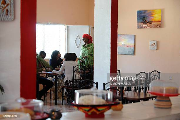 Ayan Hussein a London stylist originally from Somaliland talks with customers inside her cafe the Akulan Coffee shop in Somaliland's capital Hargeisa...