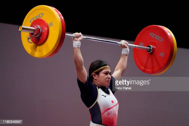 Ayana Sadoyama of Japan competes in the women's 55kg weightlifting on day one of the Ready Steady Tokyo - Weightlifting, Tokyo 2020 Olympic Games...