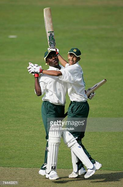 Ayanda Kolisi and team mate Lee Benting of South Africa celebrate victory against England during the International Learning Disability TriNations...