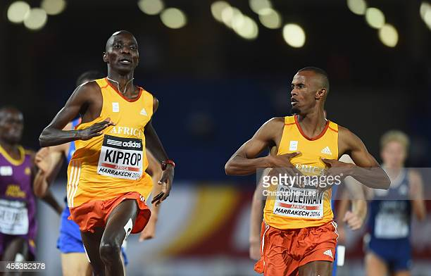 Ayanleh Souleiman of Djibouti and Africa highlights the Africa written on his shirt as he celebrates winning the Mens 1500m with Asbel Kiprop of...