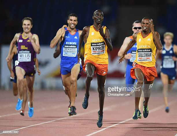 Ayanleh Souleiman of Djibouti and Africa pushes himself as he wins the Mens 1500m with Asbel Kiprop of Kenya and Africa coming second during the IAAF...