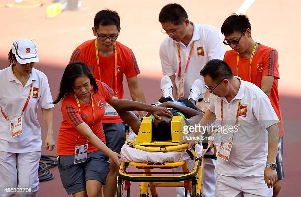 Ayanleh Souleiman of Djibouti is stretchered off after failing to finish the Men's 1500 metres heats during day six of the 15th IAAF World Athletics...