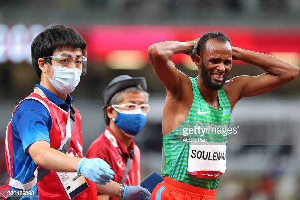 Ayanleh Souleiman of Team Djibouti is helped off the track after being injured during the Men's 1500m Semifinal on day thirteen of the Tokyo 2020...