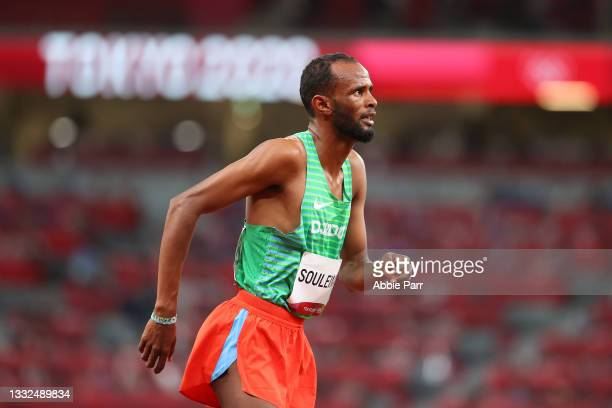 Ayanleh Souleiman of Team Djibouti limps across the track after being injured during the Men's 1500m Semifinal on day thirteen of the Tokyo 2020...