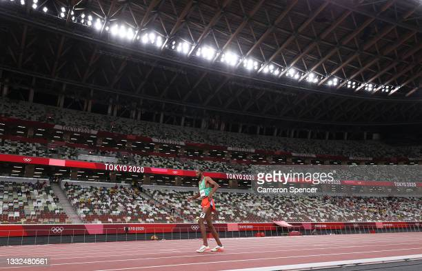 Ayanleh Souleiman of Team Djibouti limps injured in the Men's 1500m Semi Final on day thirteen of the Tokyo 2020 Olympic Games at Olympic Stadium on...